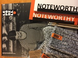 Her noteworthy soxs -two notebooks and a pair of wo men's woolly socks